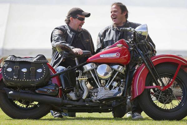 Bill Davidson (left) grandson of the founder of Harley-Davidson Motorcycles with former All Black and fellow rider Josh Kronfeld look over a 1948 14