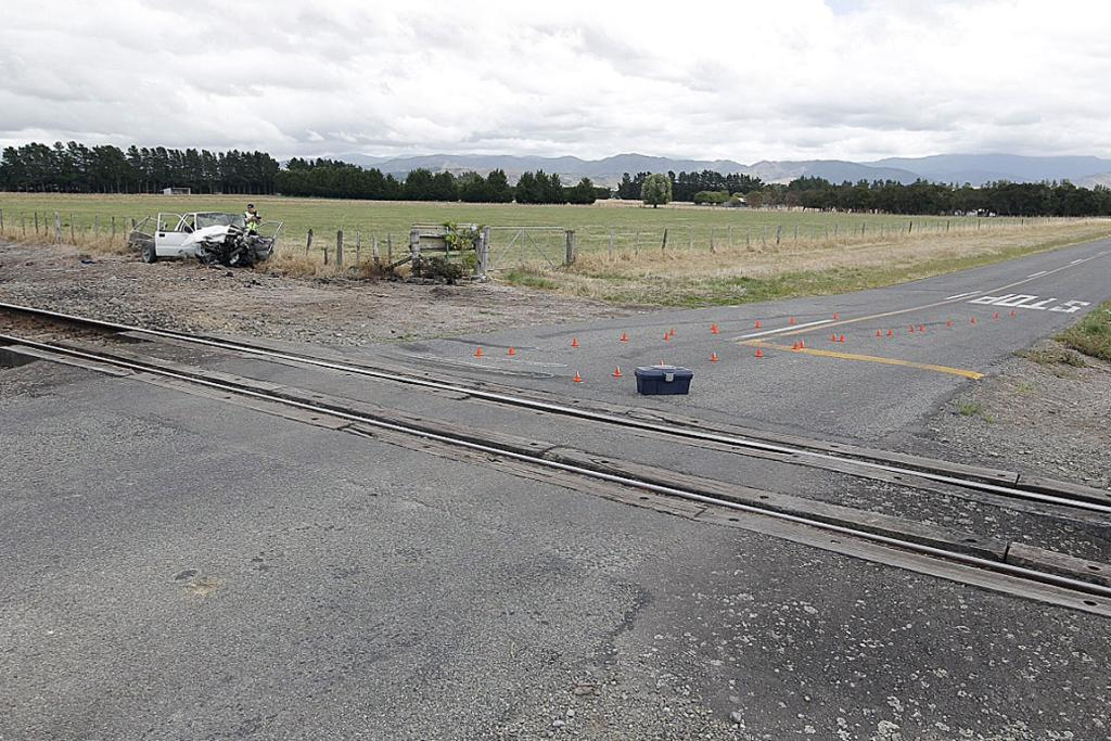 The scene of a crash involving a car and a train on Wilton Rd between Carterton and Masterton in which one person died and another was seriously injured.