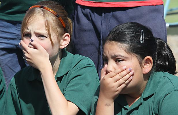 SHOCKED: Phillipstown School pupils react to the news that their school will merge with Woolston School.