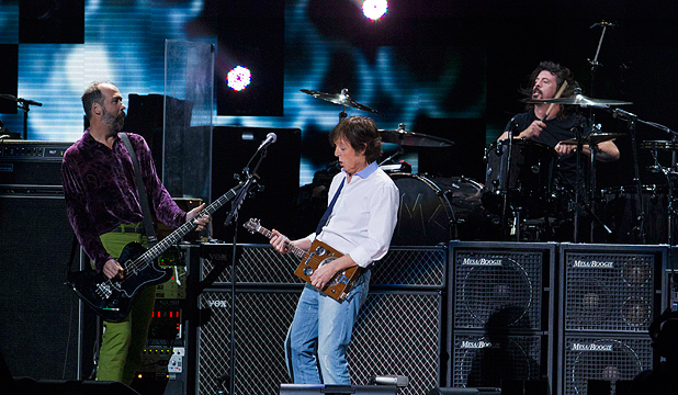 ROCKING: Nirvana's Krist Novoselic and Dave Grohl are joined by Paul McCartney at the Sandy benefit concert last week.