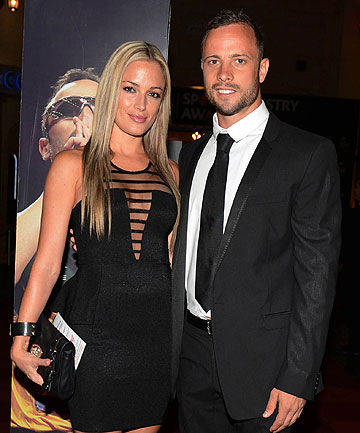 BEFORE THE STORM: Oscar Pistorius, right, and his girlfriend Reeva Steenkamp pose for a picture in Johannesburg.
