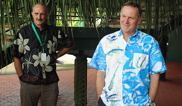 COMING HOME: High Commissioner John Carter and Prime Minister John Key in the Cook Islands last year.