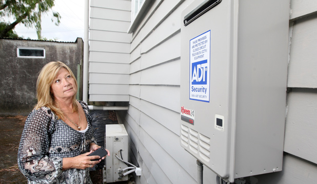 GOBSMACKED: Nicola Tombs can't believe a burglar was brazen enough to steal her continous hot water system off of her house in broad daylight and in front of a witness.