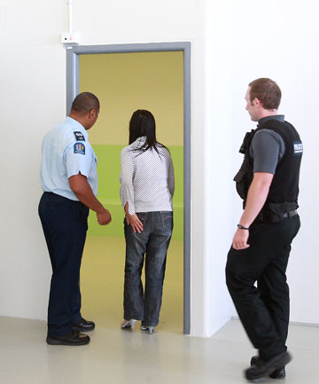 Officer Hamish Ogilvie transfers a  prisoner into the new custody suite.