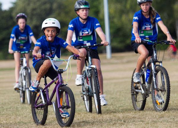 Tama Crosswell, in the white helmiet, at the Weet-bix Kids Tryathlon.