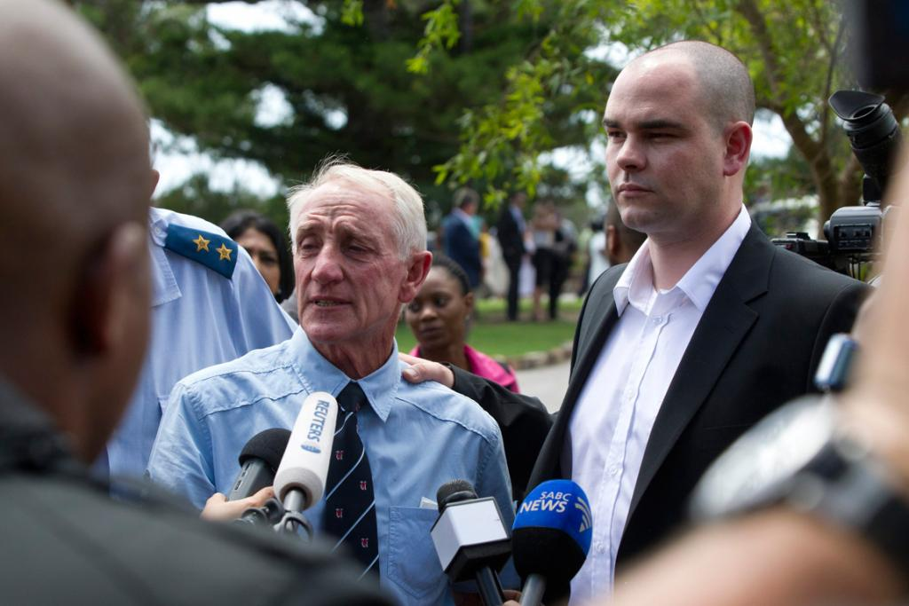 Mike Steenkamp, the uncle of model Reeva Steenkamp, and her brother Adam (R) speak to the media after a memorial service for her at the Victoria Park Crematorium in Port Elizabeth.
