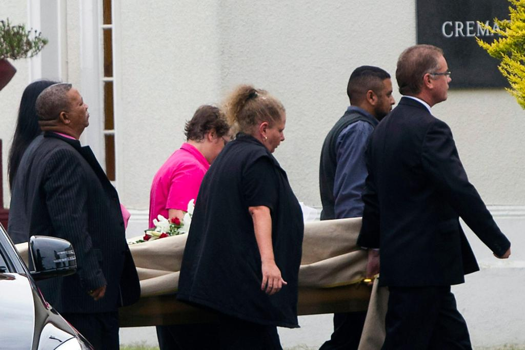 Pall bearers carry in the model's coffin ahead of the service at the Victoria Park Crematorium.