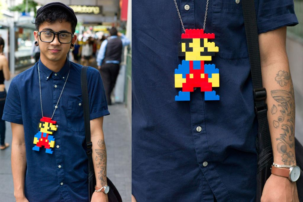 Danny, who has started a little hobby making these Lego-style necklaces, is spotted on Queen Street in Auckland.