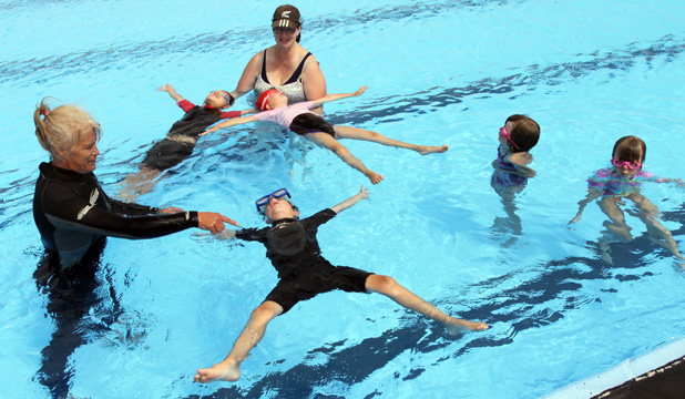 Starfish- Swim instructors Shelley Riddell and Carrie Bittle help a group of children feel at ease