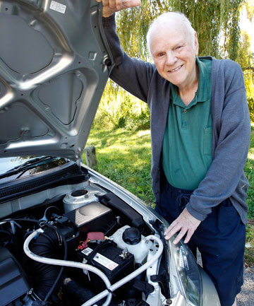 HAPPY CUSTOMER: Kapiti Coast retiree Vincent Lowe, 76, shows off the hydrogen-on-demand system he has had installed in his Toyota Corolla as a fuel-saving measure.