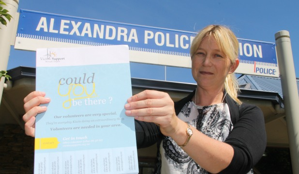 Victim Support service co-ordinator Rachael Brown holds a poster asking for members of the community to consider becoming a support worker.