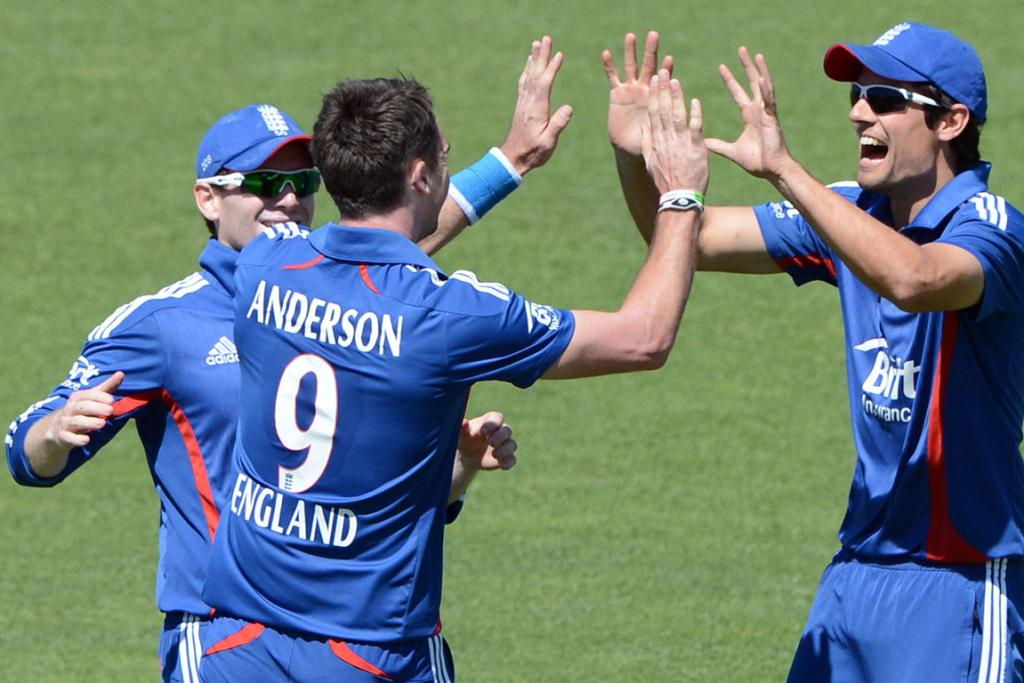 James Anderson celebrates the dismissal of Hamish Rutherford with captain Alastair Cook.