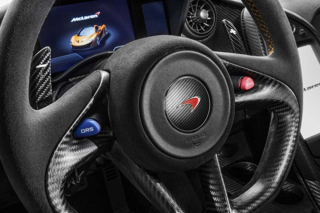The McLaren P1's steering wheel with the DRS (drag reduction system) and IPAS (instant power assist system) buttons.