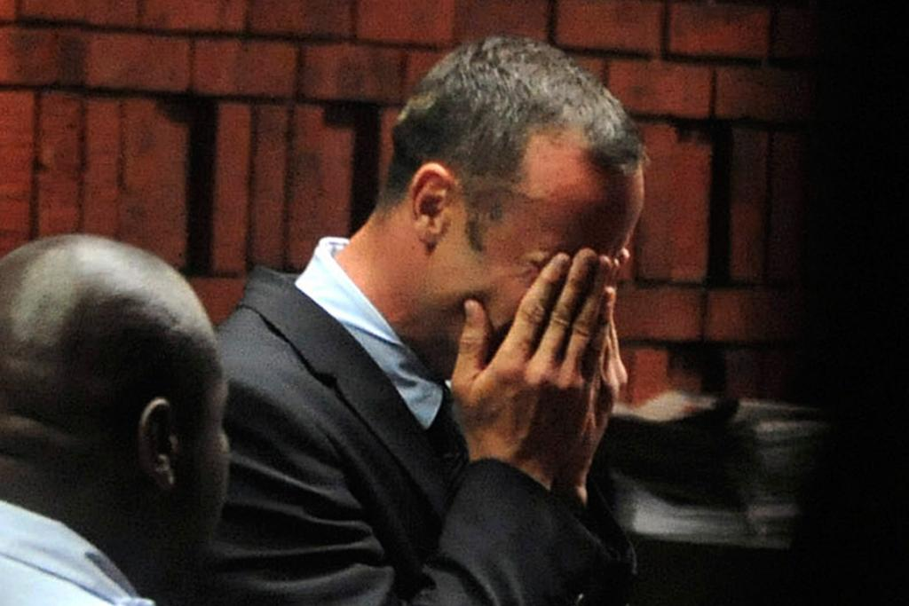 Pistorius breaks down during his first court appearance in Pretoria.