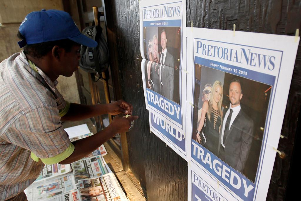 A newspaper vendor sets up his stall outside the court. The case has captured the attention of South Africa, as well as the world.