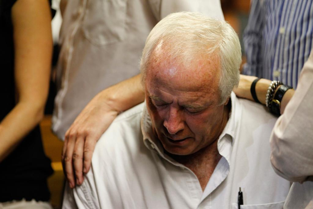 Pistorius's father Henke waits for the start of court proceedings.