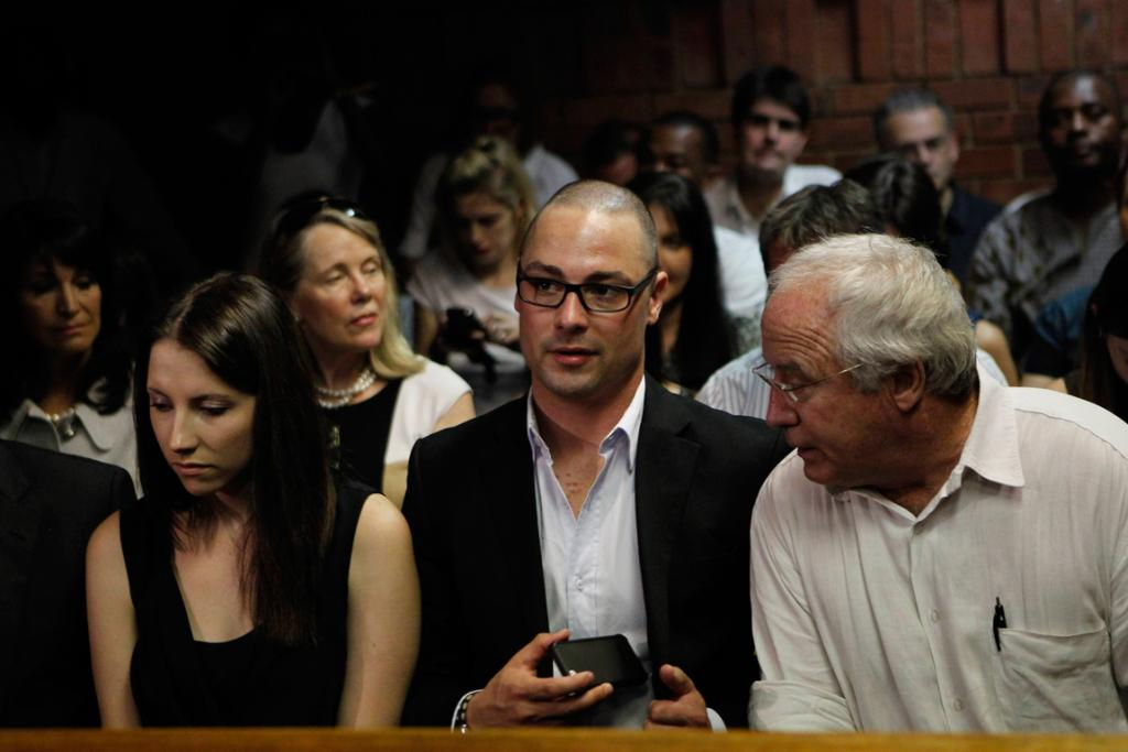 Oscar Pistorius' sister Aimee, brother Carl and father Henke.