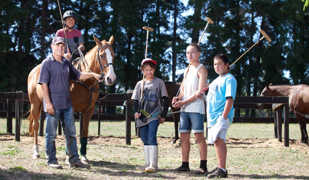 No horsing around: From left, Birchleigh Polo Club manager Richard Kettle, Zario Hura-Hokianga, 12, Satriani Hokianga, 12, Shellico Hura-Hokianga, 13,  Codie Irwin, 12.