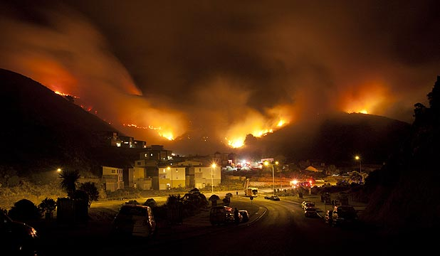 HUGE BLAZE: The bush fire threatens houses at the bottom of Owhiro rd, Wellington.