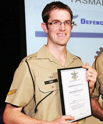 MOURNED: Lance Corporal Duncan Orr receiving the award that enabled him to come to NZ.