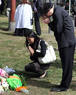 Mourners attend a memorial in Latimer Square for students and staff at King's Education who died in the 2011 earthquake.