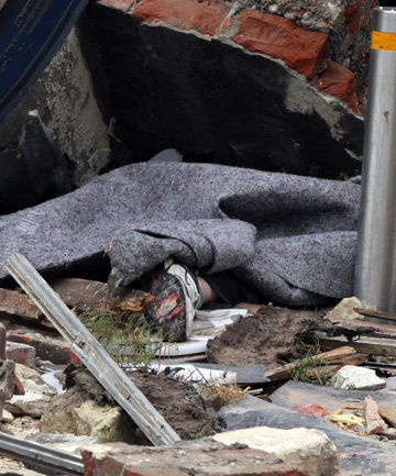 CHILLING: Olivia Cruickshank's foot protrudes from the rubble.