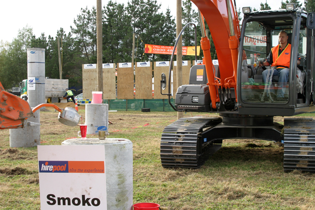 Jonathon Noonan, of Hawera puts his digger skills to work pouring smoko at the National Excavator Operator Competition finals in Feilding 2010
