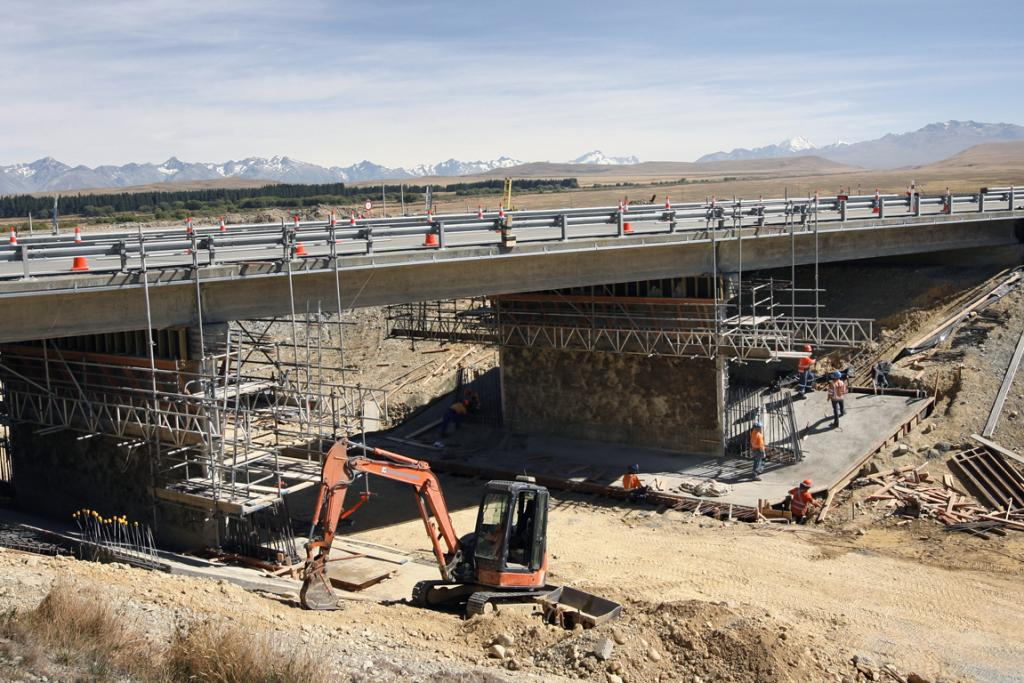 UNDER THE BRIDGE: Contractors are hard at work reinforcing the State Highway 8 bridge, but at least they will get some protection from the shade.