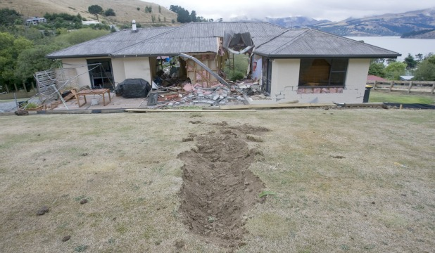 Rapaki home, boulder damage