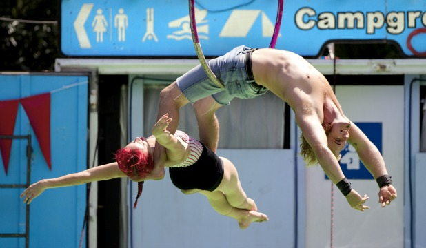 Acrobat Zach Washer bends over backwards supporting Jessica Judge