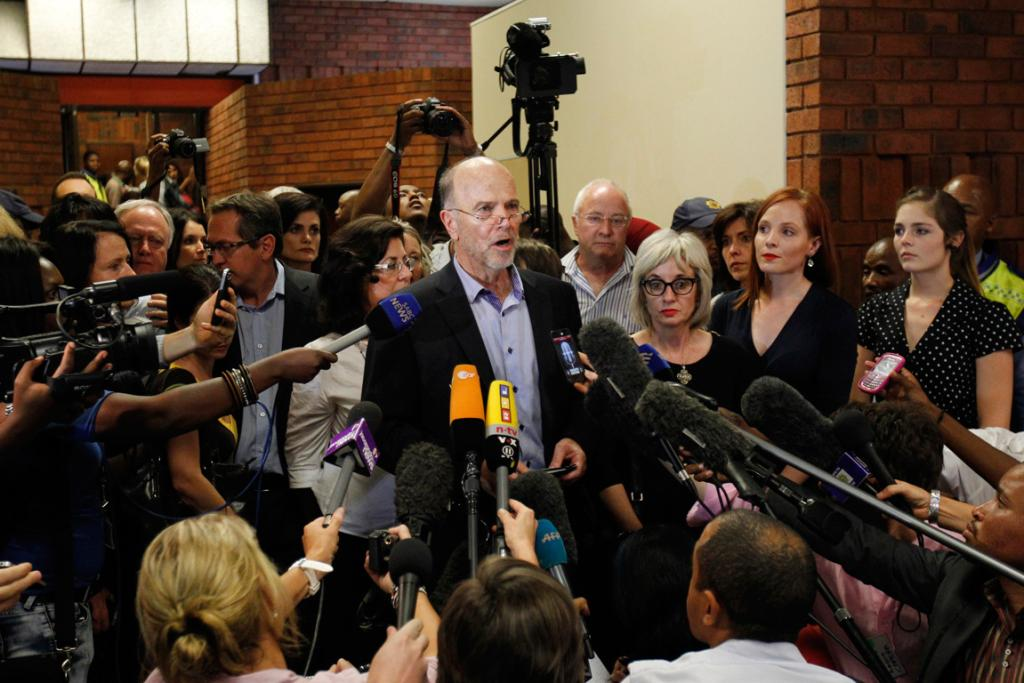 Arnold Pistorius, uncle of Oscar Pistorius, talks to the media after the hearing.