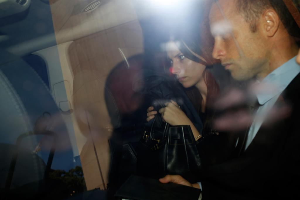 Oscar Pistorius and his sister Aimee leave the Pretoria Magistrates court.