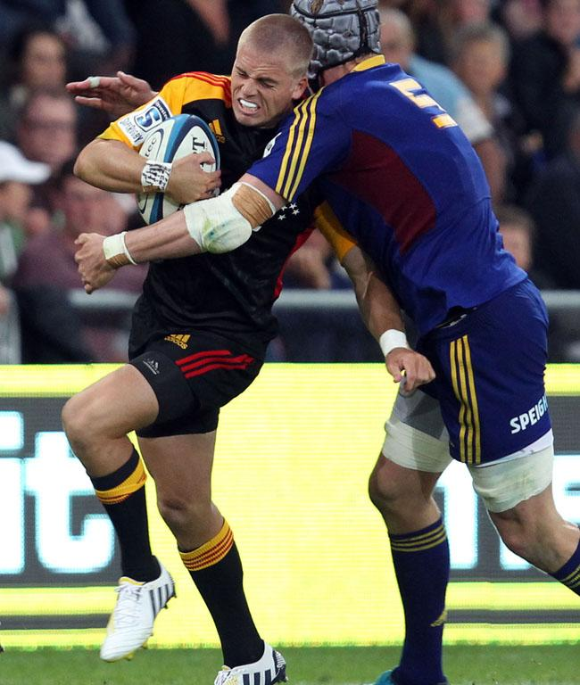 Gareth Anscombe gets caught in a tackle on his Chiefs debut against the Highlanders.