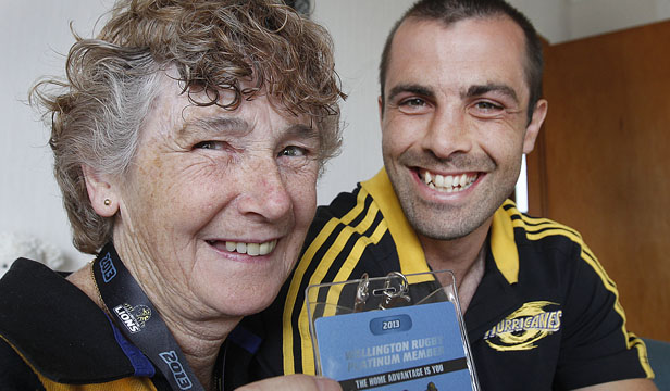 FAN FARE: Marion van Borssum receives a season pass from Conrad Smith. The Hurricanes would do well to have a woman giving advice, she says.