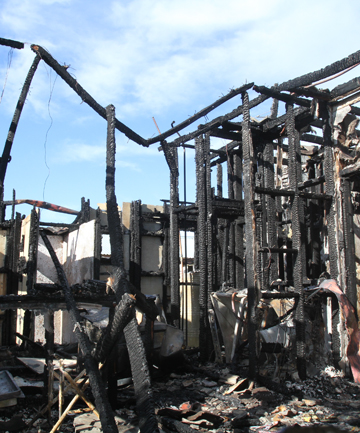A South Taranaki house was gutted by a fire early this morning