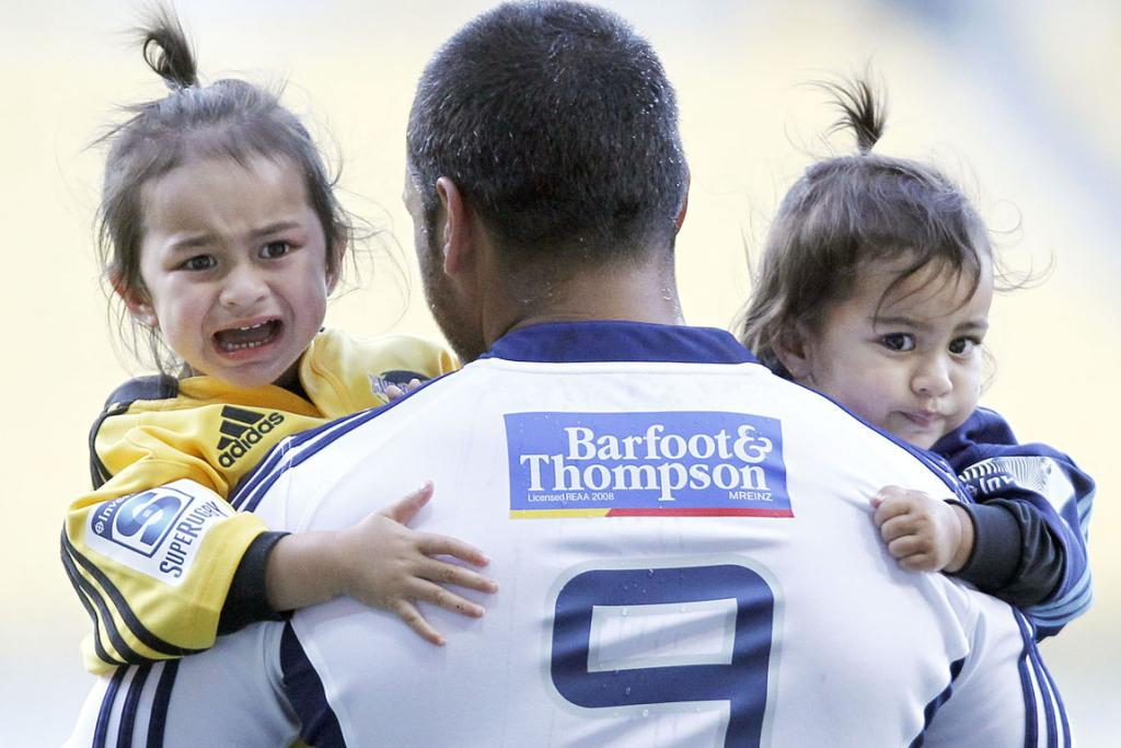 But dad!...Piri Weepu's daughter Keira doesn't look too happy about sharing in her fathers 100th Super Rugby game celebrations.