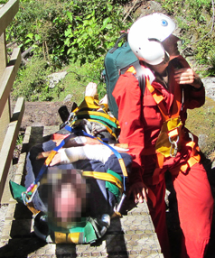 Te Anau doctor Stephen Hosking waits for a Southern Lakes helicopter's longline to lift him with his patient from the bush, who fell down a waterfall on the Stockyard Track at Lake Manapouri.