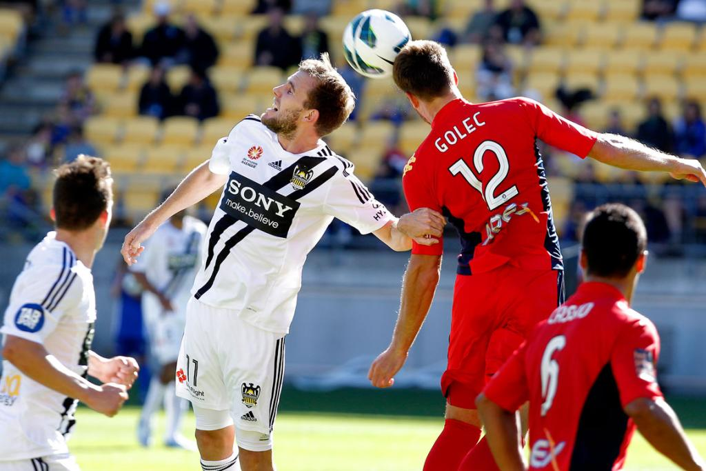 Wellington's Jeremy Brockie, left, and Antony Golec jump for the ball.