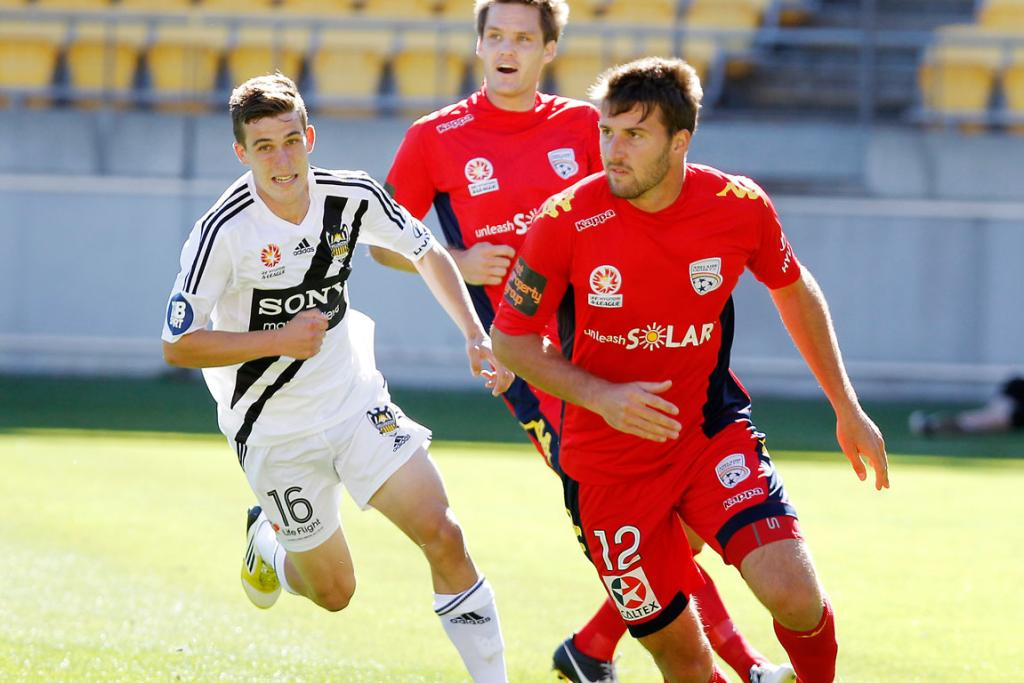 Antony Golec of Adelaide runs with the ball.