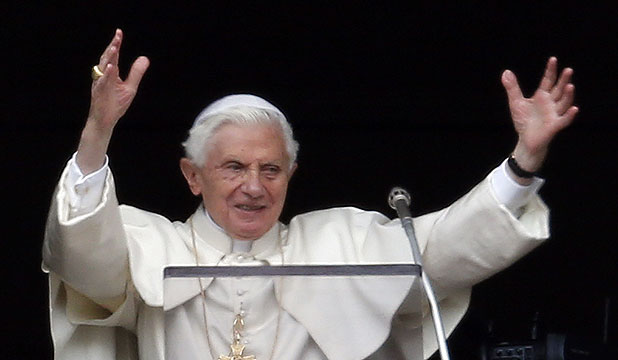 TIME COMING TO AN END: Pope Benedict XVI waves as he leads his last Sunday Angelus prayer before stepping down.