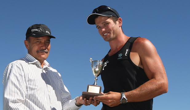 AWARDED: The Governor-General, Lt Gen Rt Hon Sir Jerry Mateparae present Nathan Cohen a trophy for NZ male rower of the year.