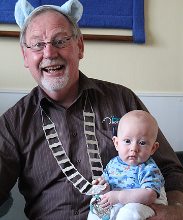 GREAT APPEAL: Plunket youngster Elijah Neilsen, 4 months, plays with the mayoral chains as Morris Cutforth helps launch Plunket's Bear Hug Appeal.