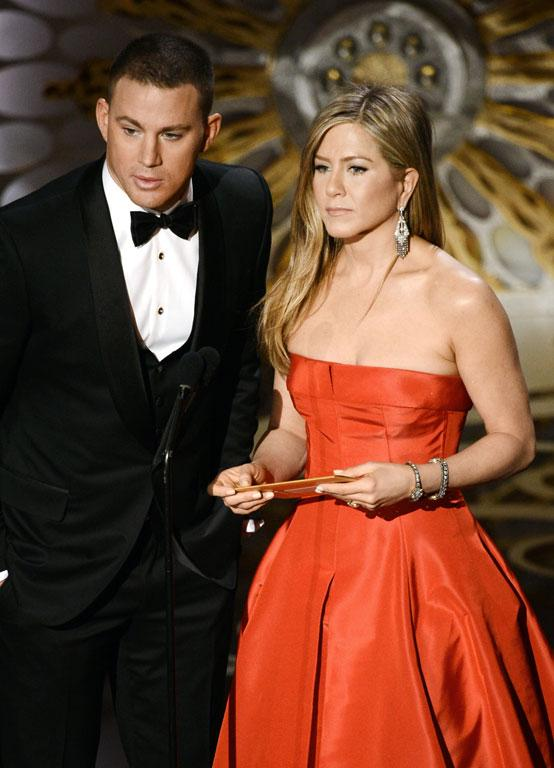 Actor Channing Tatum and actress Jennifer Aniston onstage.