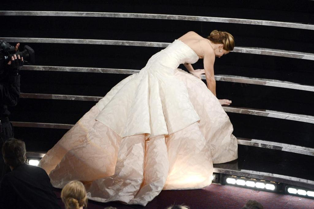 Actress Jennifer Lawrence trips as she goes to accept her award for Best Actress for her work in Silver Linings Playbook.