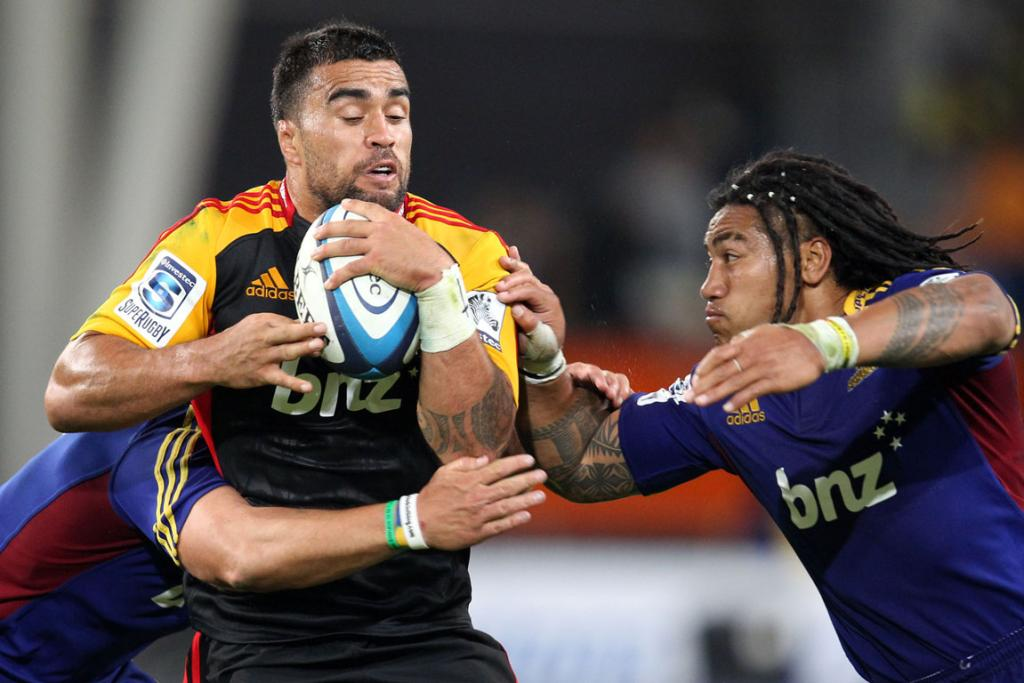 Liam Messam tries to avoid the tackle of Ma'a Nonu during his side's opening round win over the Highlanders.