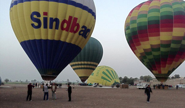 BEFORE THE DISASTER: Balloons take off near Luxor about 40 minutes before one exploded and fell from the sky.
