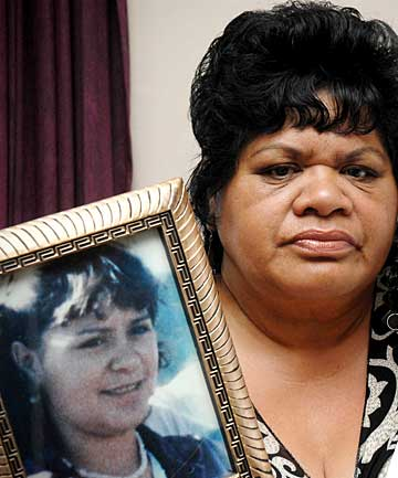 Ida Hawkins with a picture of her slain daughter Colleen Burrows