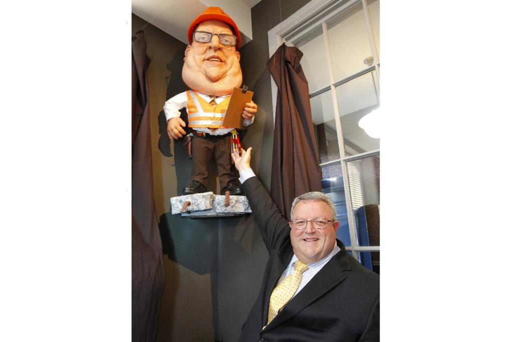 National minister Gerry Brownlee with his puppet likeness, decked out for the Christchurch rebuild.