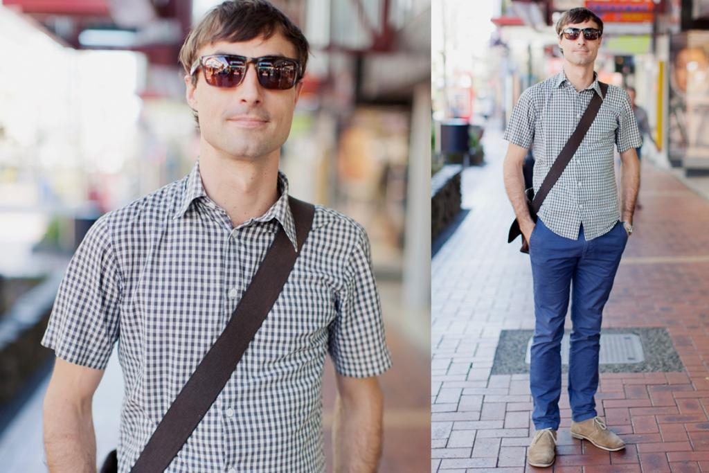 James, photographed on Cuba St, Wellington, wearing Little Brother shirt, Carhartt chinos and Country Road shoes, with a Bisonte satchel from Melbourne.