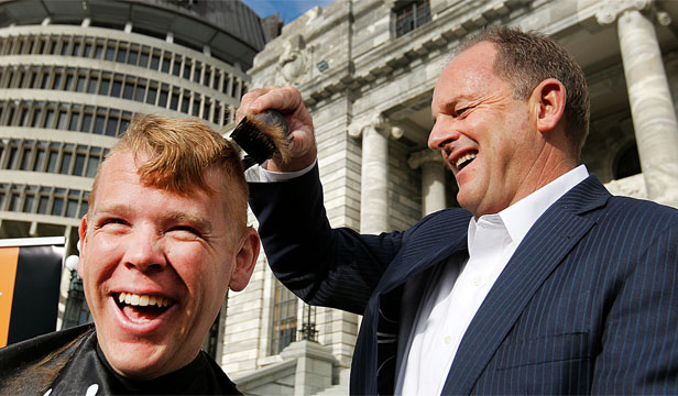 FOR THE CAUSE: Labour MP Chris Hipkins trusted Labour leader David Shearer to shear his red locks for charity.